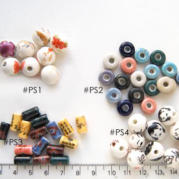 *Mallikappale-Poistomyynti* #PS4 -Posliinihelmiä, 'poika', 'tyttö' & kiinalaista tekstiä, noin 10-12mm, 4 kpl