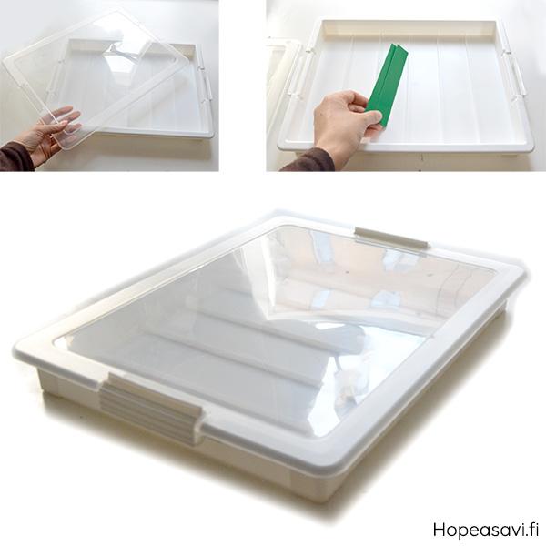 *Muuttoale -mallikappale* Kannellinen säilytyslaatikko esim koruille tai helmille, muovia, läpinäkyvä kansi, koko noin 35x27x4.5cm