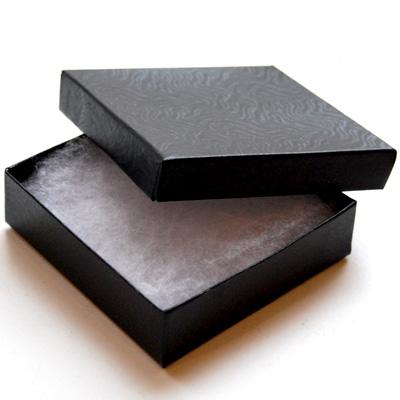 *Tarjous* Korurasia, musta, pehmustettu, 90x90x25mm, TUKKUPAKKAUS 10 KPL
