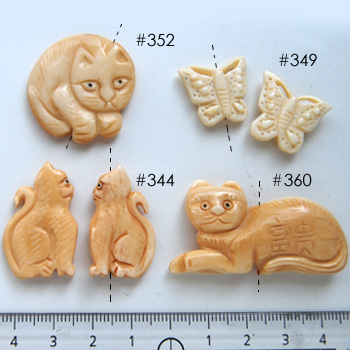 *Mallikappale-Rajoitettu erä* Designerhelmiä, kuvassa #344, Luuhelmi, kissa, noin 30x18x8mm, 1 kpl, OVH 3.26