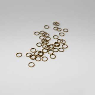 Välirengas, pronssinruskea, patinoitua kullattua messinkiä, pyöreä, ulkomitta 6.0mm, lanka 0.8mm, noin 100kpl