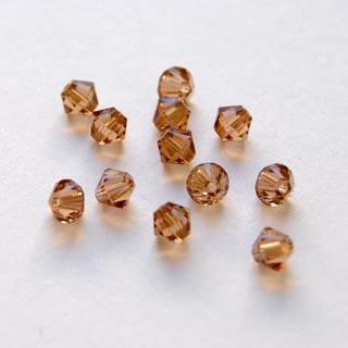 Swarovski Crystal, Tumma Topaasi, 4mm, bicone (säihkyvä heijastus), 8 kpl