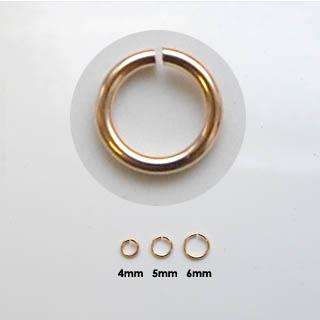 Välirengas, pronssi, pyöreä, ulkohalkaisija noin 5.5mm, langan paksuus 0.7mm, noin 100 kpl