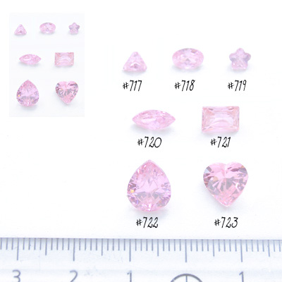*Mallikappale-poistoale* Kuutiollinen zirkonia, kuvassa #717, pinkki, kolmio, 4x4mm, 1 kpl
