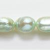 *Erä* Helmiä, aito, erittäin kaunis makeanveden helmi, kuvassa #Q-03, mintun vihreä (värjätty), ovaali noin 8mm, nauha 40cm, OVH 21.80