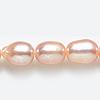 *Erä* Helmiä, aito, erittäin kaunis makeanveden helmi, kuvassa #Q-14, persikka/pinkki, ovaali noin 7x5mm, nauha 35cm, OVH 11.00