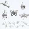Maskotti, hopeoitua messinkiä, setti: lepäkerttu, kilpikonna, perhonen, lintu, jne, noin 5-25mm, 15 kpl kuin kuvassa