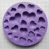Muotti, joustavaa silikonia, Sydämiä, monta erilaista mallia (muotin ulkohalkaisija noin 11cm)